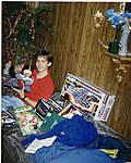 Christmas pictures from back in the day!-12.87-doug-w-christmas-presents.jpg