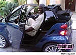 Tall people--what do you drive?-shaqsmartcar.jpg