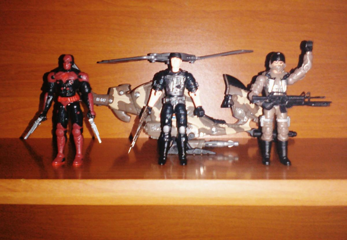 This is my Tiger Storm Copter from G.I. Joe vs. Cobra 2004 series. From left to right: Sand Viper (v3), Recondo (v4) and Wild Bill (v8).